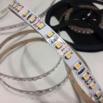 Светодиодная лента премиум класса smd 3528 теплое белое свечение, на белой основе, 120 led на 1 метр